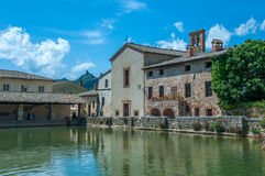 Ancient swimming pool with thermal water in Bagno Vignoni, Tusca Stock Photos