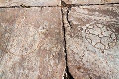 Ancient symbols stone background stock image