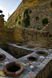 Thermopolium,  Herculaneum. Ancient Taberna with storage pots in Scavi Ercolano, Campania, Italy. Thermopolia were Take-away places for the citizens Stock Images