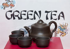 Ancient Tea Serving Pot and Cups Stock Photo