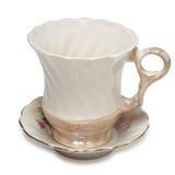 Ancient teacup on saucer. Stock Photos