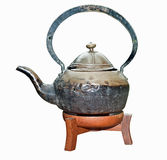 Ancient teapot on wood support. Royalty Free Stock Photography