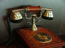 Ancient telephone. Wooden and metallic Stock Images
