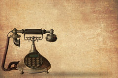 Ancient telephone on old paper. Notes background Royalty Free Stock Photo