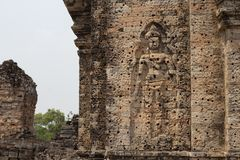 Ancient temple in Angkor Wat complex. Buddhist temple Pre Rup with stone carving bas-relief human figure. Khmer architecture heritage. Tourist place of stock photo
