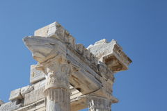 Ancient Temple of Apollo in Side. Marble fragment of the Temple of Apollo decorated with symbols of power: faces of gods, image of a lion also testicles in Side Royalty Free Stock Photos