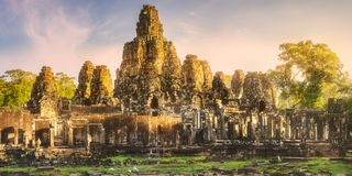 Ancient temple Bayon Angkor Siem Reap, Cambodia. Sunrise view of ancient temple Bayon Angkor complex with stone faces of buddha Siem Reap on sunset, Cambodia Royalty Free Stock Photography