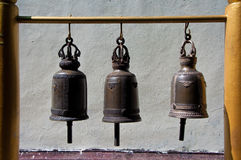 Ancient temple bells. Hung on wooden pillar Stock Image