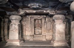 Ancient bas-relief in Ellora caves, Maharashtra, India. Ancient temple in Ellora caves, India. It is one of the largest rock-cut monastery-temple cave complexes stock photos