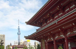 Ancient temple and modern tower in tokyo Stock Photo