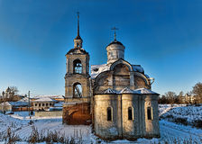 Ancient temple. Old church in the winter on a photo of the blue sky Stock Images