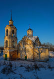 Ancient temple. Old church in the winter on a photo of the blue sky Stock Image