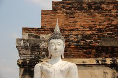 Ancient Temple With One White Buddha. Ruins.  Old Buddha statuary with bricks walls Buddhist historical park. summertime in Ayutthaya Thailand royalty free stock photo