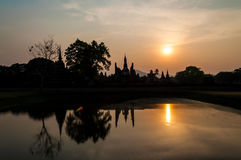 Ancient temple ruin silhouette sunset sky. Silhouette of ancient ruin in Thailand against sunset sky. The temple named Wat Mahathat, part of Sukhothai historical Stock Images