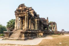 Ancient temple ruins at Angkor Wat. A Buddhist temple at Angkor Wat in Siem Reap Cambodia. This historic building is one of the many ruins at this archaeological royalty free stock image
