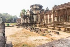 Ancient temple ruins at Angkor Wat. A Buddhist temple at Angkor Wat in Siem Reap Cambodia. This historic building is one of the many ruins at this archaeological royalty free stock photo