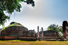 Ancient temple ruins. Thai ancient temple ruins on the lawn Royalty Free Stock Image