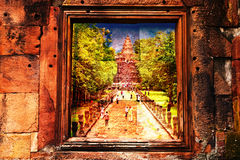 Ancient temple on stone wall Royalty Free Stock Image