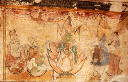 Old mural of the god kamatchi amman with devotees on a wall in the ancient Brihadisvara Temple in Thanjavur, india. Ancient temple-UNESCO World Heritage centre Stock Photo