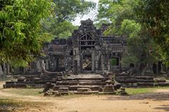 Ancient temple view near Angkor Wat, Siem Reap, Cambodia. Temple gate ruin in greenery. Popular tourism destination place. Travel and sightseeing in Angkor Stock Photography