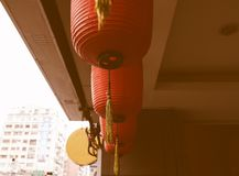 Ancient temples are hung with red lanterns, contrasting with modern architecture, symbolizing tradition and modernity, and conserv Stock Photos