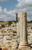 Ancient temples in main touristic attractions of Cyprus island - Kourion. Ruins of rome ancient. Old white and black marble royalty free stock photography