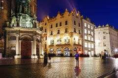 Ancient tenements by Main Market Square (Rynek) in Krakow, Polan Stock Photo