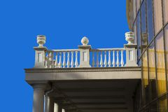 An ancient terrace with stucco fretwork. Old terrace with a fence in the monograms and patterns under the open blue sky Stock Photo