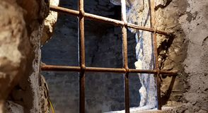 Castle rusted jail view. Ancient terrifying jails in italian castle with views through the bars royalty free stock photos