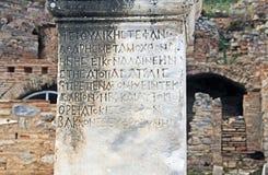 Ancient Text on a Marble Pillar in Ephesus, Turkey royalty free stock photos