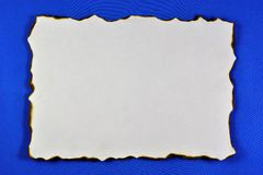 The ancient texture of old paper, the background for the creativity of writing. Vintage grunge paper with dark edges, blue. Background for literary composition royalty free stock photos