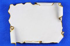 Ancient texture of old paper scroll, background for writing creativity. Vintage paper scroll with dark edges, blue background for. Literary composition royalty free stock photos