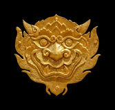 Ancient Thai art golden lion-singha isolated on black background Royalty Free Stock Photography