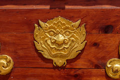 Ancient Thai art golden lion-singha. On wood background Stock Images