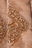 Ancient Thai Bas-Relief Close Up. An ancient Thai Bas-Relief Close Up made from mud and carved by hand one by one Royalty Free Stock Images