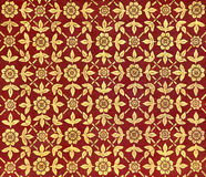 Ancient Thai Design on The Ceiling of a Palace With Patterns of Golden Leaves and Flowers on Red Background Royalty Free Stock Photos