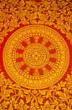 Ancient Thai Mural painting of a religious symbol. Ancient Thai Mural painting of a Buddhist wheel on the temple's door Stock Photo