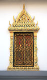 Ancient Thai pattern style wall. And door of temple in grand palace, Bangkok Thailand Royalty Free Stock Image
