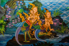 Ancient Thai-style murals in the thai temple. Stock Photo