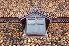 Ancient thai style window at roof Stock Photos