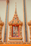 Ancient Thai temple. Wat Kosit Wihan golden Temple Phuket, Thailand. Decor architecture wall. Royalty Free Stock Image