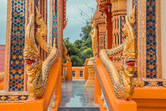Ancient Thai temple. Wat Kosit Wihan golden Temple Phuket, Thailand. Stairs entrance dragons. Stock Photo