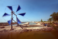 Ancient Thai traditional water wheel pump and wind mill. Royalty Free Stock Photography