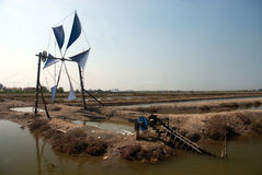 Ancient Thai traditional water wheel pump and wind mill. Stock Image