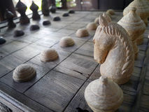 Ancient Thai wooden chess were lined on the board Stock Photo