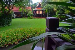 Ancient Thailands style palace with lawn. Ancient Thailands style palace behide with lawn Royalty Free Stock Photos