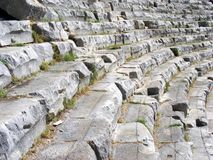 Ancient theater. The ancient theater with neat rows of stone seats and passages for the audience Stock Photography