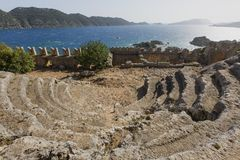 Antique amphitheatre of the ancient site of Simena, Antalya, Turkey. Ancient theatre built by the Lycians in the ancient site of Simena, near the town of Kas Royalty Free Stock Images