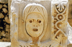 Ancient theatre ornament. Woman face bas-relief in the ancient greek theatre Stock Photography