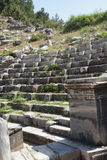 Ancient theatre with rows of stone seats, Royalty Free Stock Photo